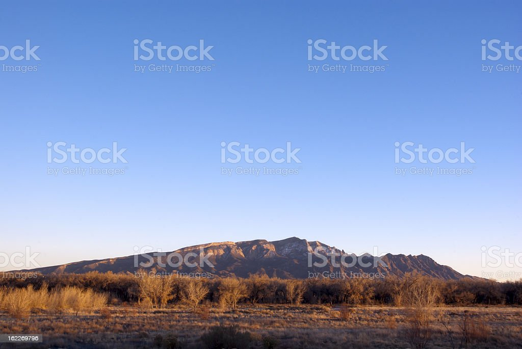 Sandia Mountains with clear sky at sunset stock photo
