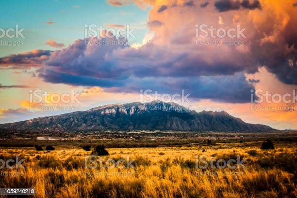 Photo of Sandia Mountains with Majestic Sky and Clouds