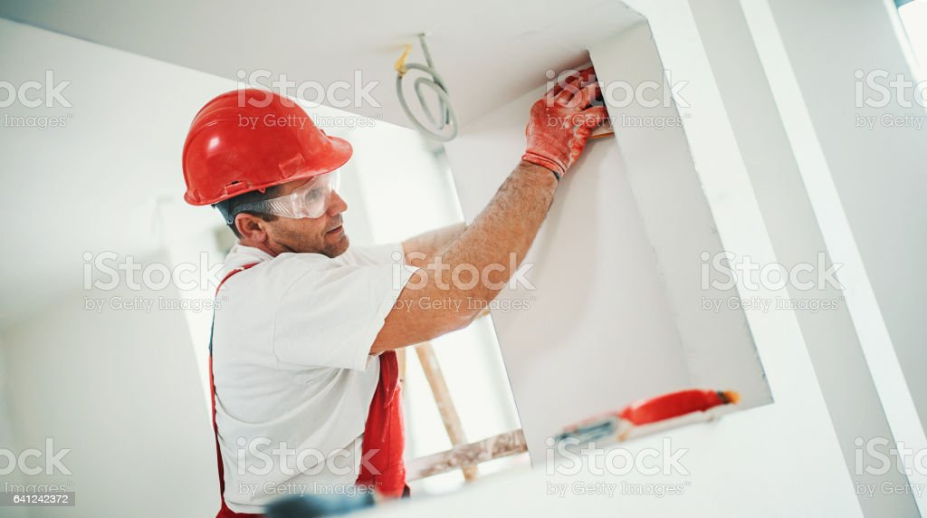 Sanding a drywall. stock photo