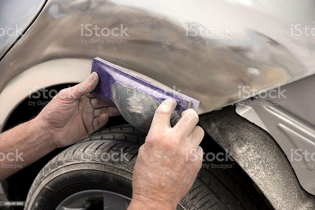 Sanding car body stock photo