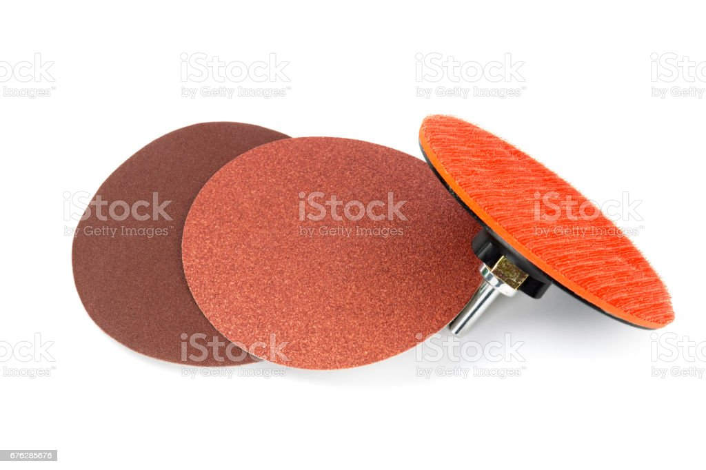 Sanding discs and angle grinder sanding attachment isolated stock photo