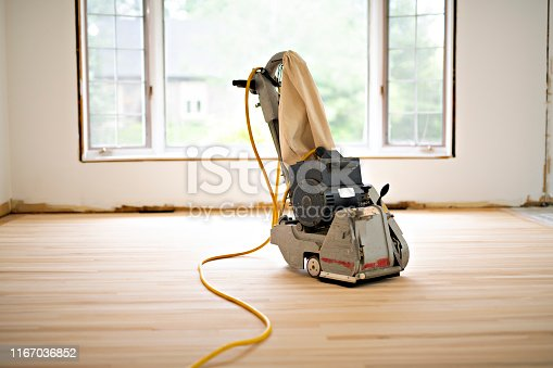 A Sanding hardwood floor with the grinding machine only tool