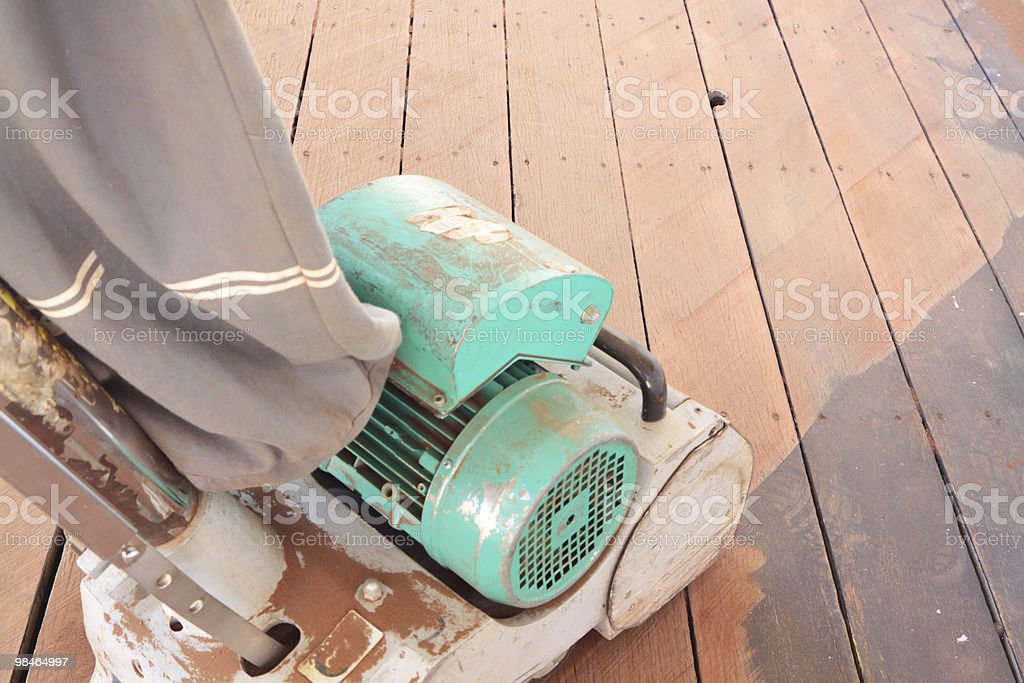 Sanding the deck royalty-free stock photo