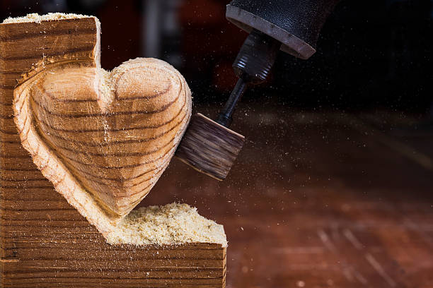 sanding wood heart close - dremel wood stock photos and pictures