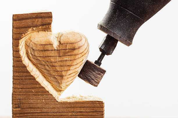 sanding wood heart, close - dremel wood stock photos and pictures