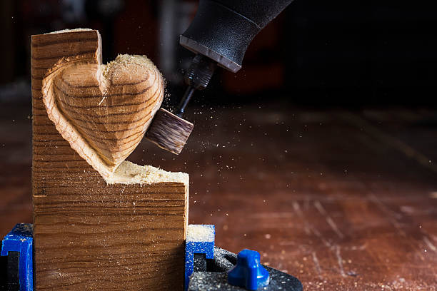 sanding wood heart - dremel wood stock photos and pictures