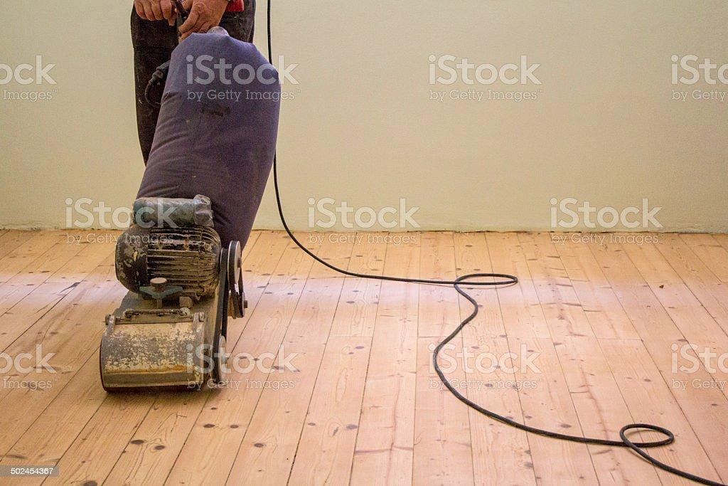Sanding wooden floor stock photo