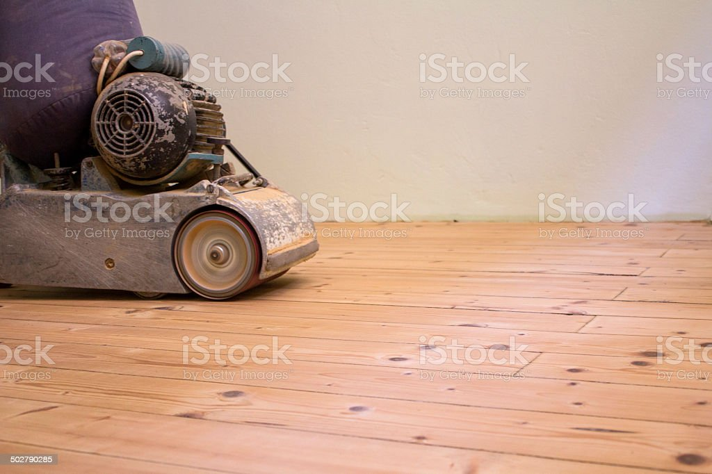 Sanding wooden floor stock photo