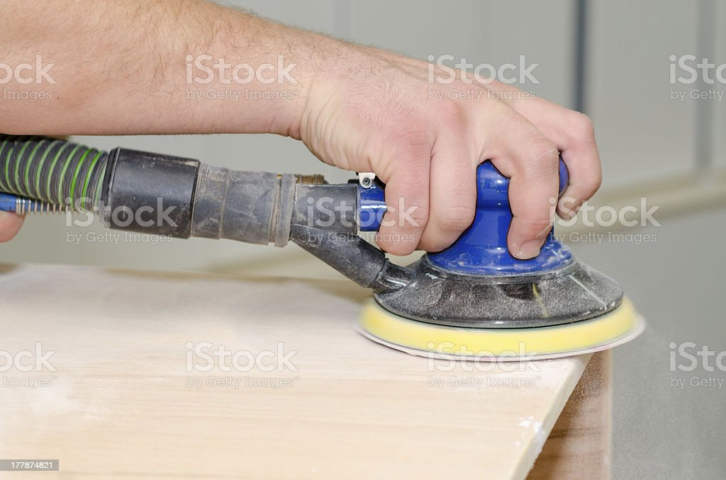 Sanding wooden surface royalty-free stock photo