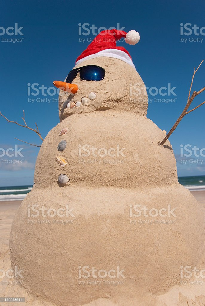 Sandman With Sunnies And Santa Hat royalty-free stock photo