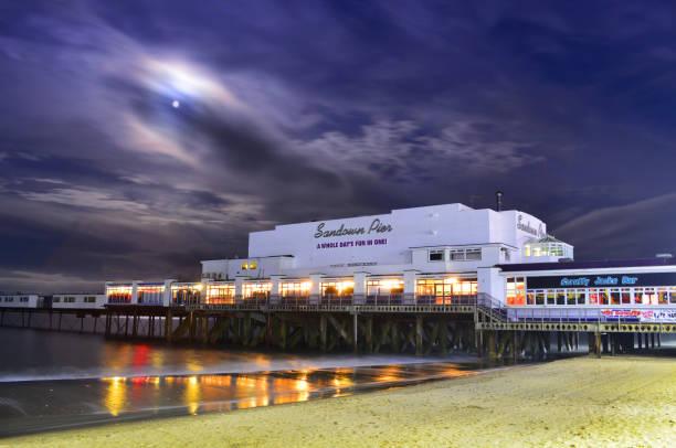 Sandown Pier and Beach Under a Full Moon stock photo