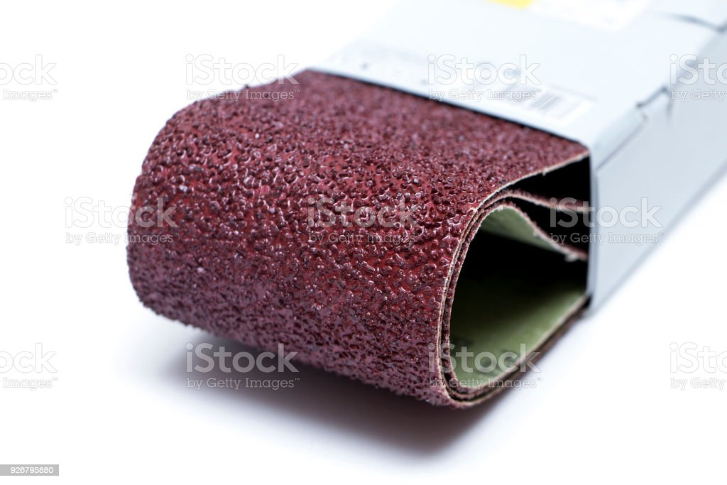 sandpaper on white background stock photo