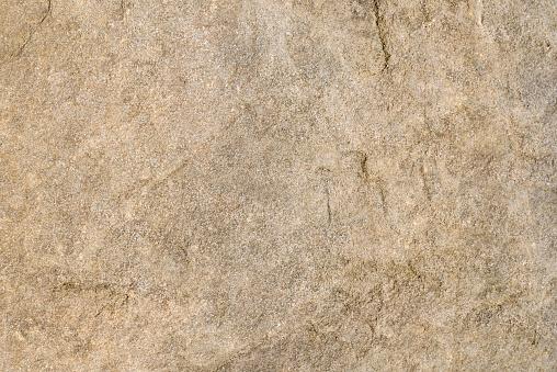 Detailed textured background of sandstone.