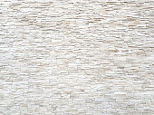 Sandstone brick wall texture and background.