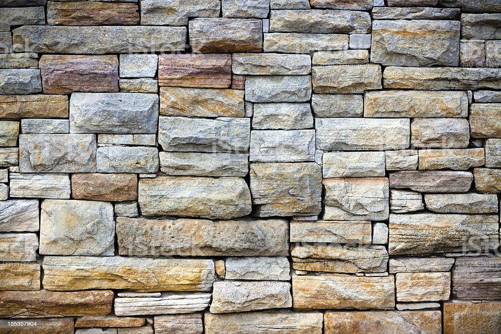 Sandstone bricks wall with vignette stock photo