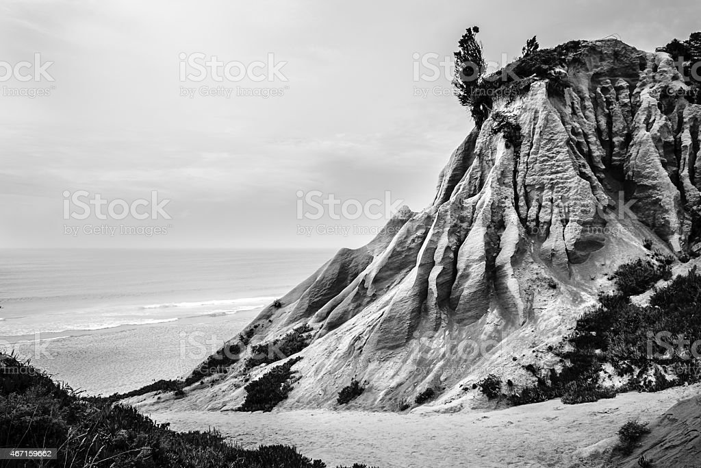 sandstone cliff forming strange shapes and textures stock photo