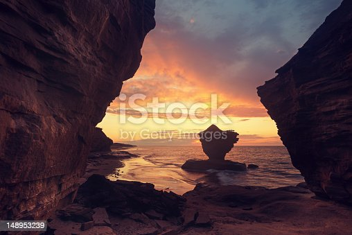 A striking rock formation known locally as the 'Teacup' silhouetted against a dramatic sunset on Prince Edward Island's North coast.http://www.pbase.com/shaun/image/144760783.jpg