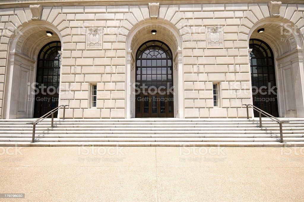 Sandstone Facade Arches Entrance to IRS Building Washington, DC, USA stock photo
