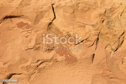 Yellow and red sand stone formation at the rocky shore or beach on the Greek Island of Chios in the Aegean Sea.