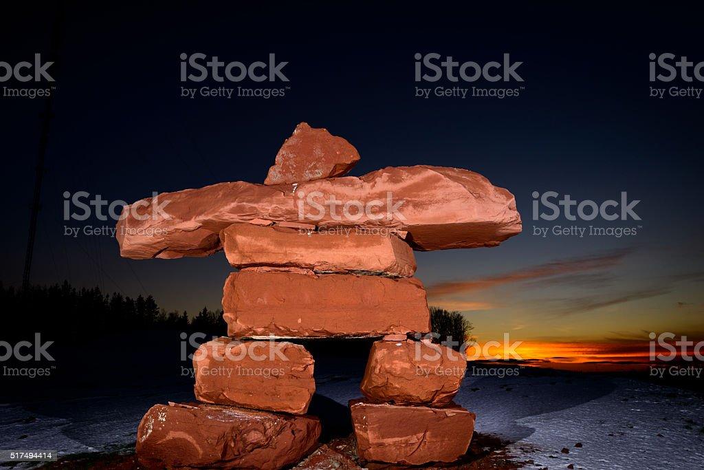 PEI Sandstone Inukshuk at sunset stock photo