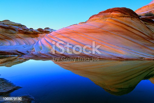 Water and quartz in rock bend light to create colors of rainbow.  Vermilion Cliffs National Monument.  Arizona, U.S.A.