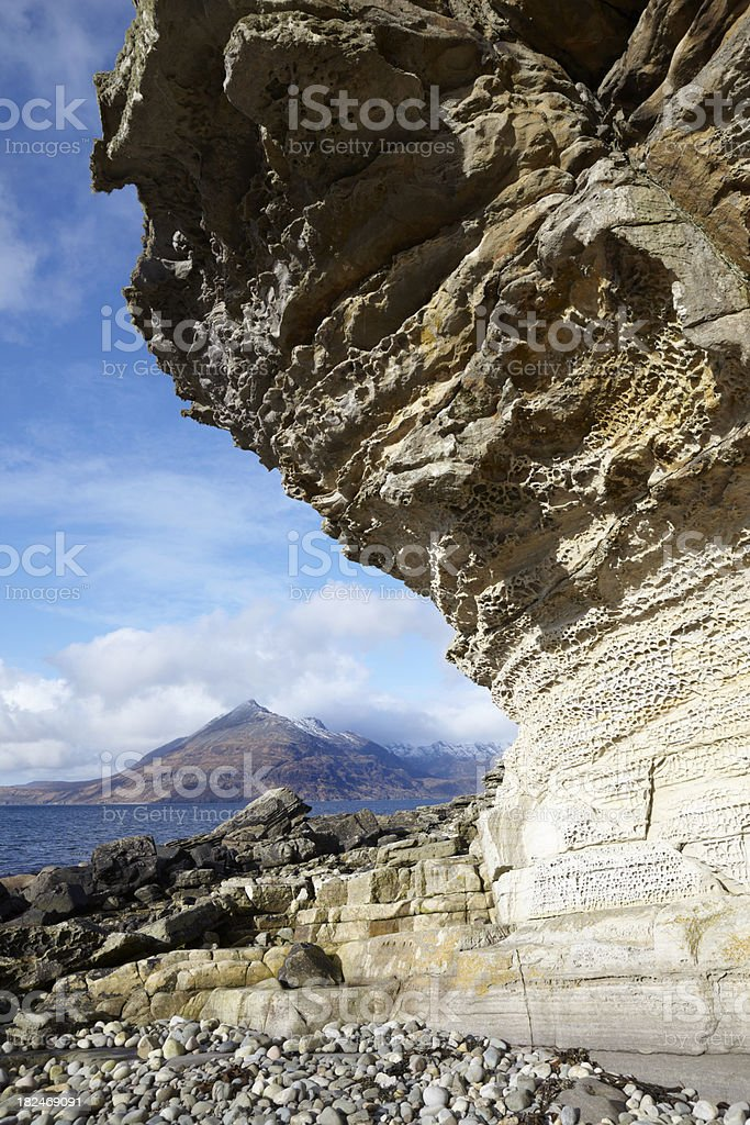 Sandstone rock at Elgol beach, Skye and Cuillin mountains, Scotland stock photo