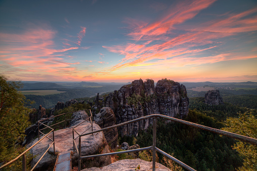 istock Sandstone rocks, forests and blue sky 486697376