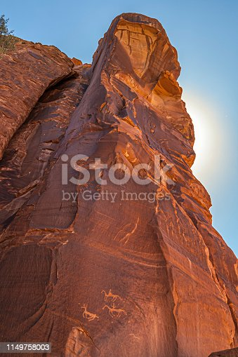 Sandstone rocky formation at Canyon de Chelly National Monument, with Anasazi petroglyphs. Vertical composition. Arizona, USA.