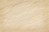 istock Sandstone wall texture in natural pattern with high resolution for background and design art work. 853803962