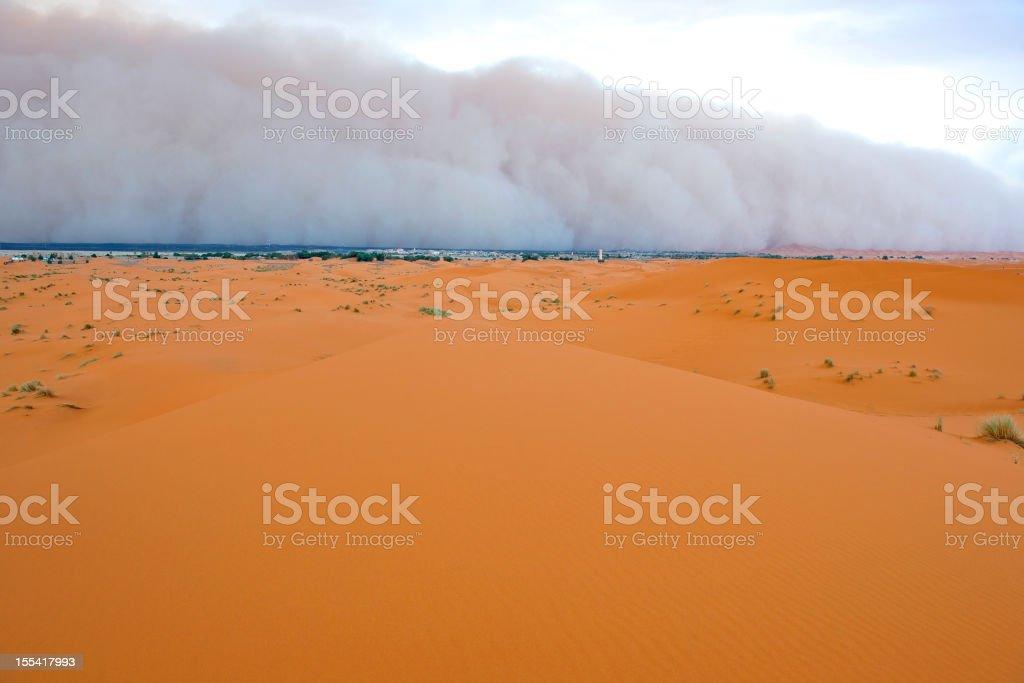 Sandstorm Approaching Merzouga Settlement royalty-free stock photo