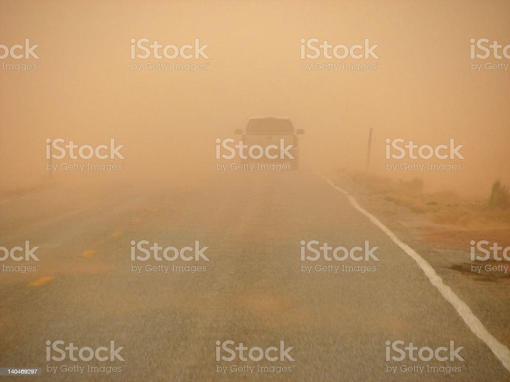 sandstorm driving stock photo