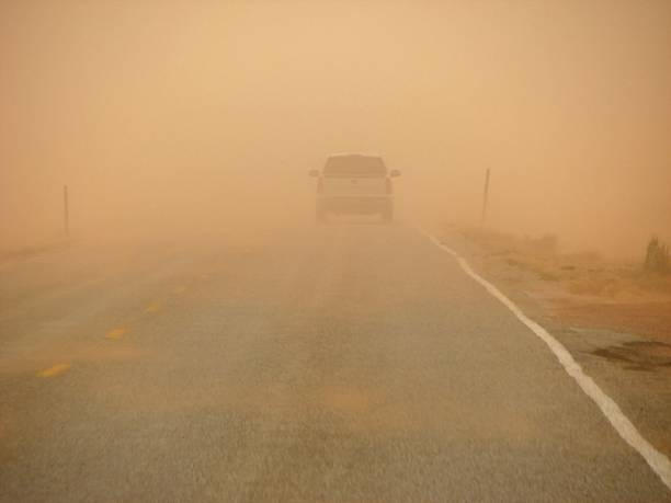 sandstorm driving stock photo