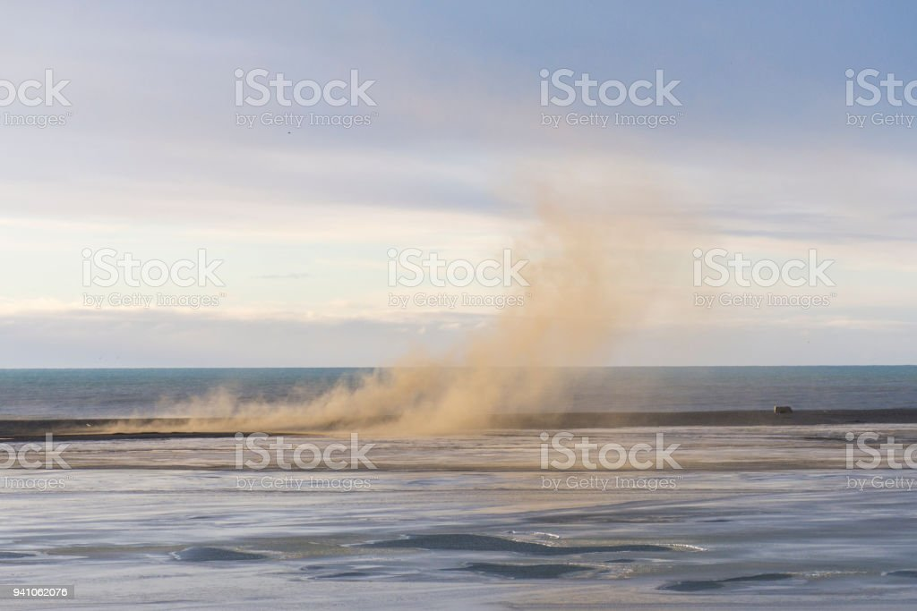 sandstorm in Iceland winter over the sea stock photo