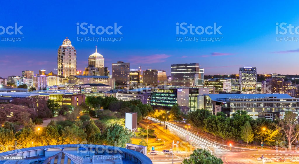 Sandton city evening panorama with evening traffic stock photo