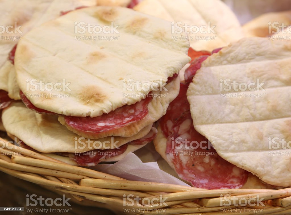 sandwhiches stuffed with sliced salami and for sale at the delic stock photo