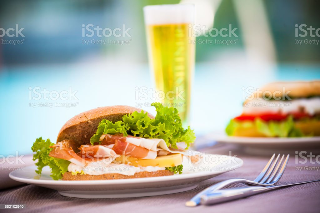 Sandwich and Beer by Poolside stock photo