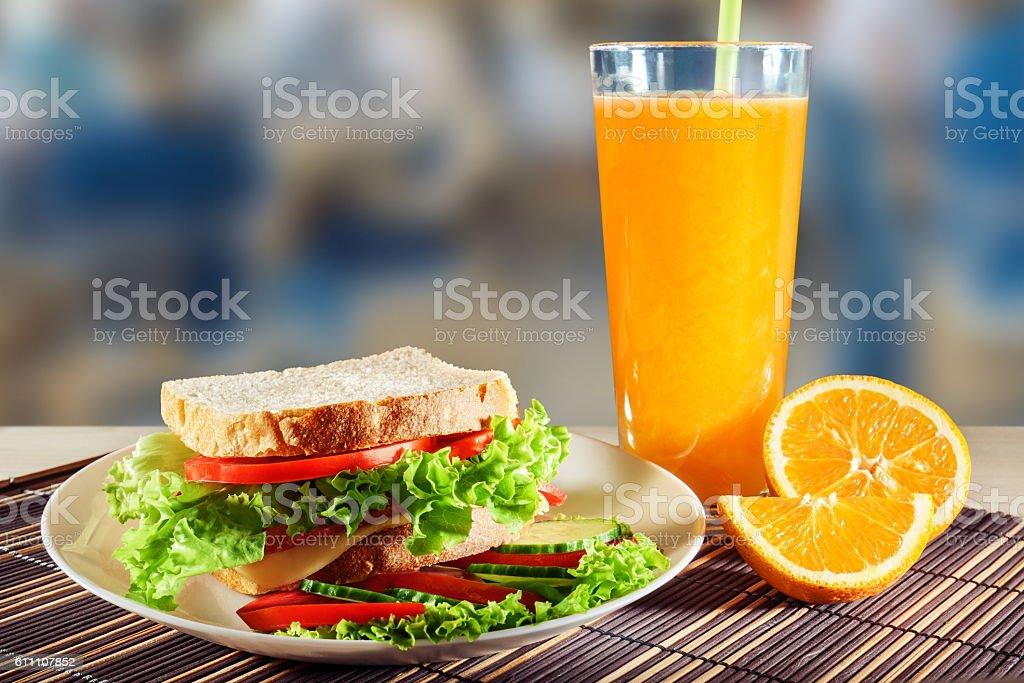 Sandwich and orange juice stock photo