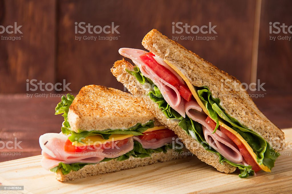 Sandwich bread tomato, lettuce and yellow cheese stock photo