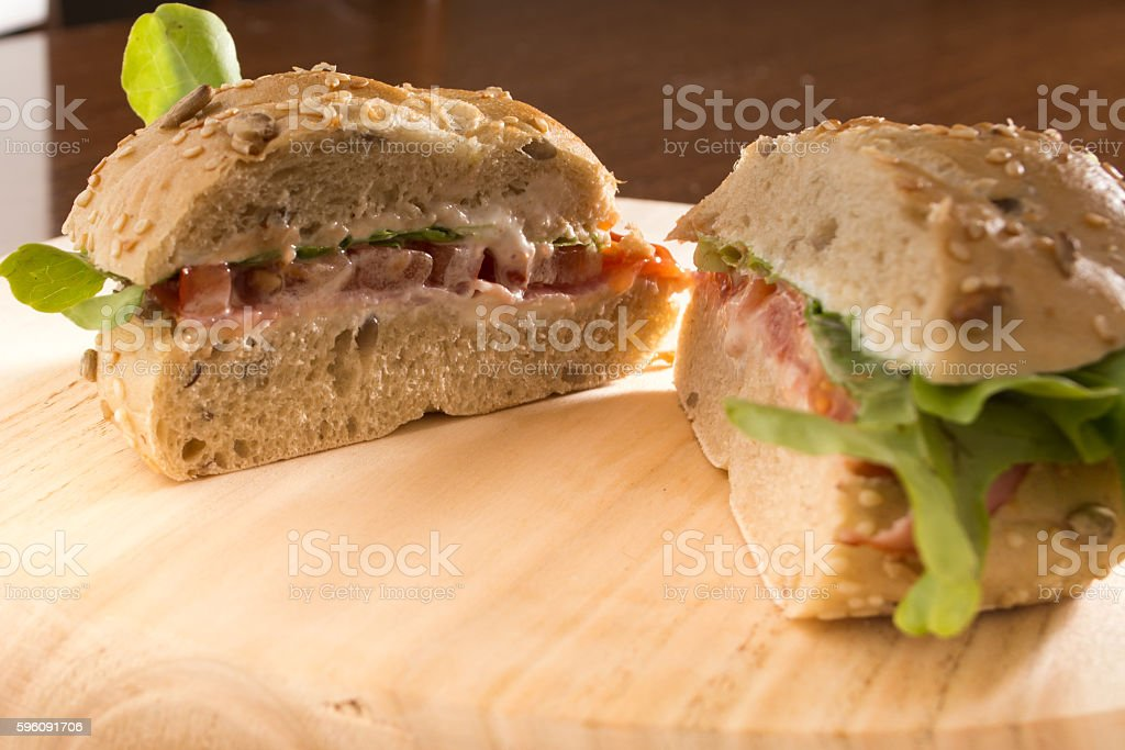 Sandwich cut in half with fresh smoked meat royalty-free stock photo