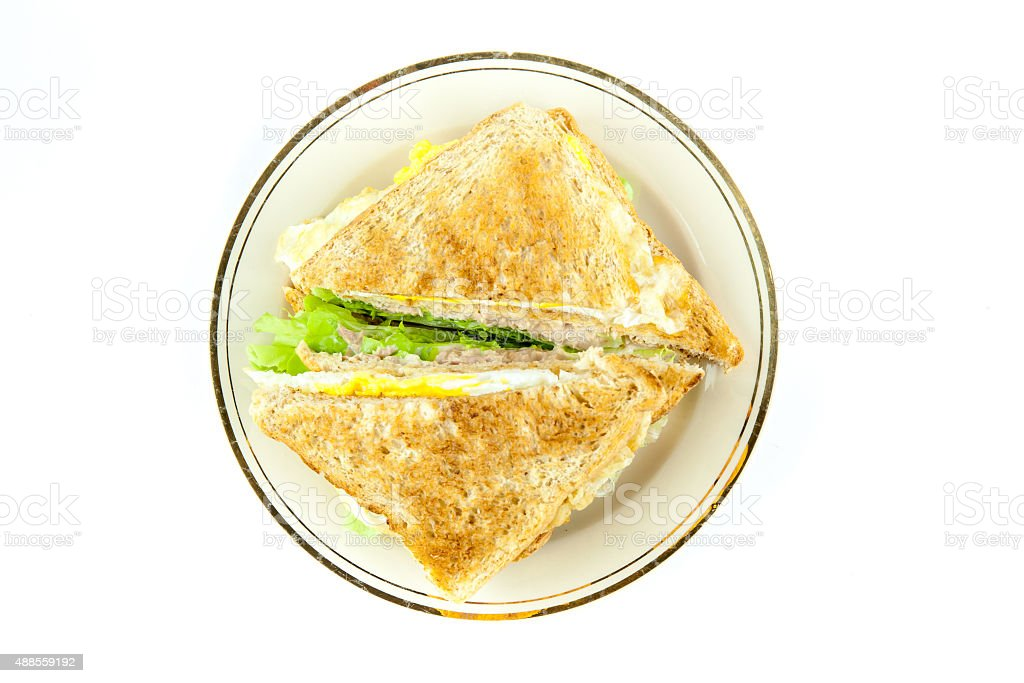 Sandwich full of tuna and lettuce vegetables sliced in half stock photo