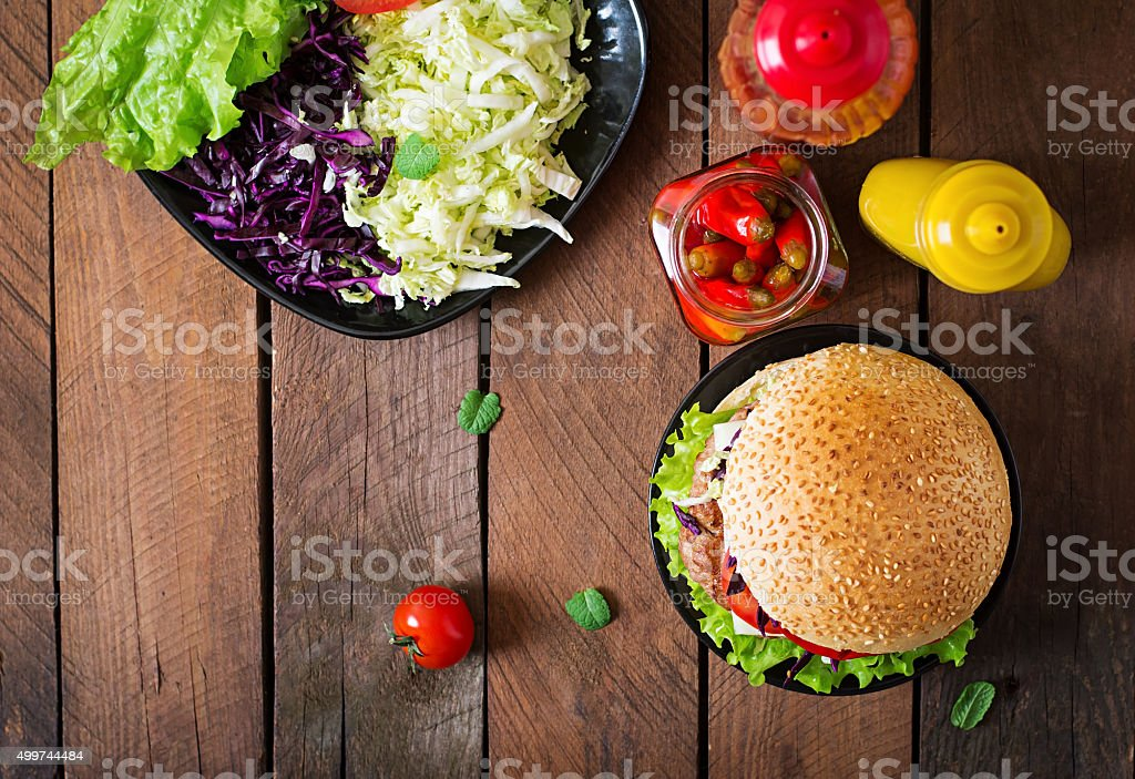 Sandwich hamburger with juicy burgers, cheese and mix of cabbage stock photo