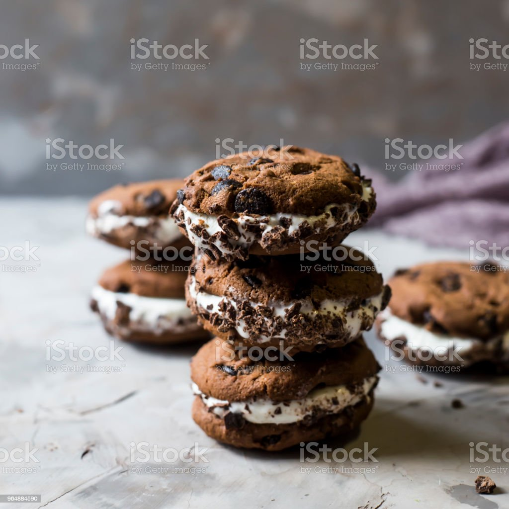 Sandwich ice cream with chocolate cookies on a gray background. Summer dessert concept royalty-free stock photo