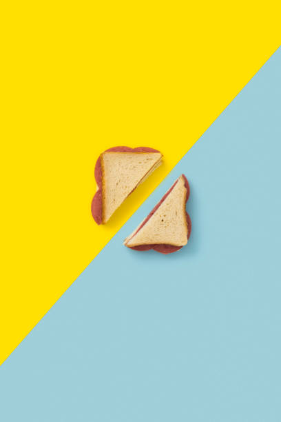Sandwich on blue and yellow background stock photo
