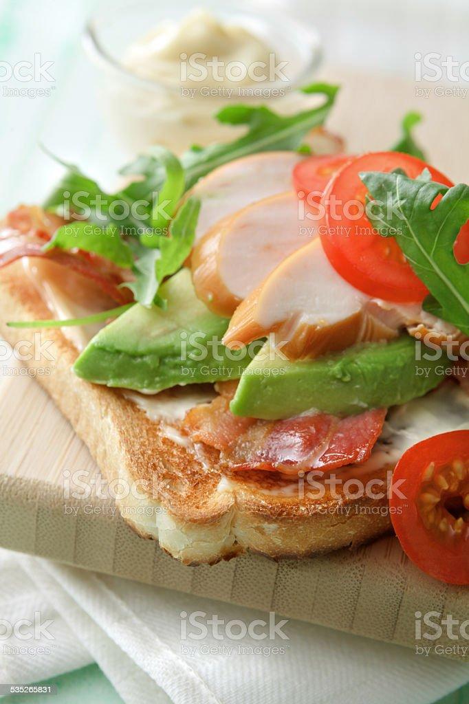 Sandwich Stills: Smoked Chicken, Avocado, Bacon, Arugola and Tomato stock photo