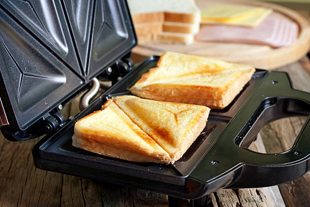 Sandwich toaster with toast stock photo