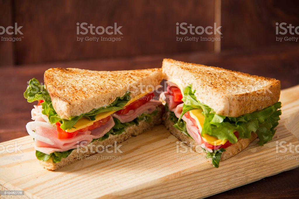 Sandwich tomato, lettuce, onion and yellow cheese stock photo