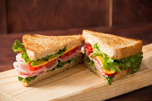 sandwich di pomodoro, lattuga, cipolle e giallo formaggio - panino ripieno foto e immagini stock