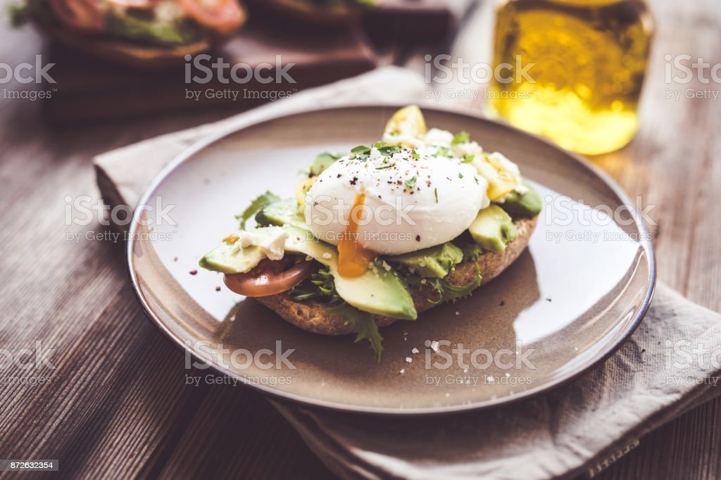 Sandwich with avocado and poached egg stock photo