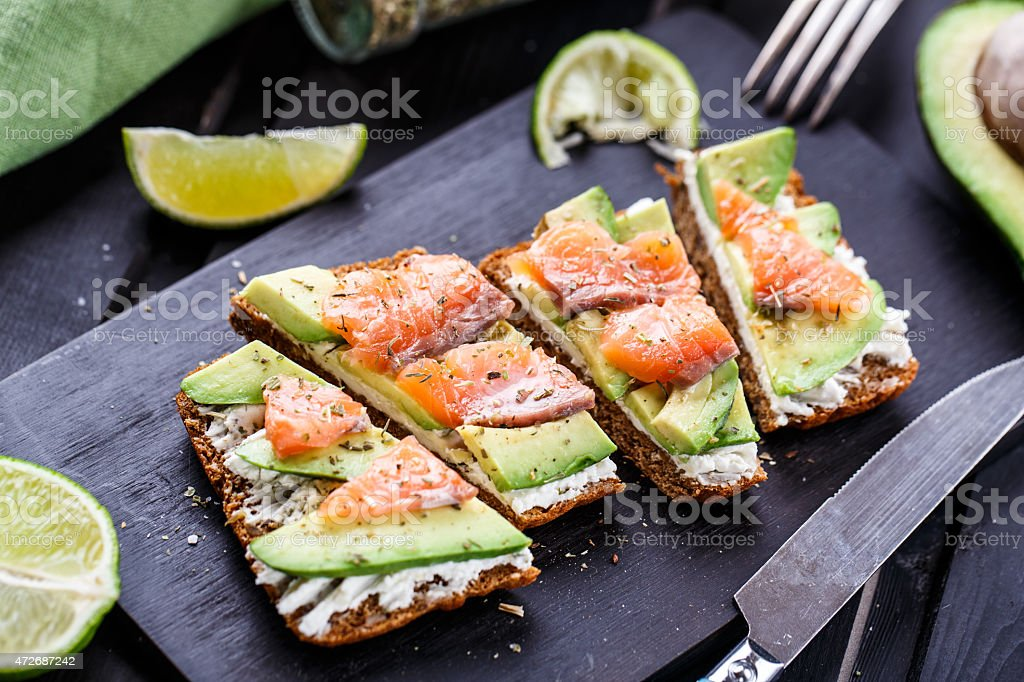 Sandwich with avocado and smoked salmon stock photo