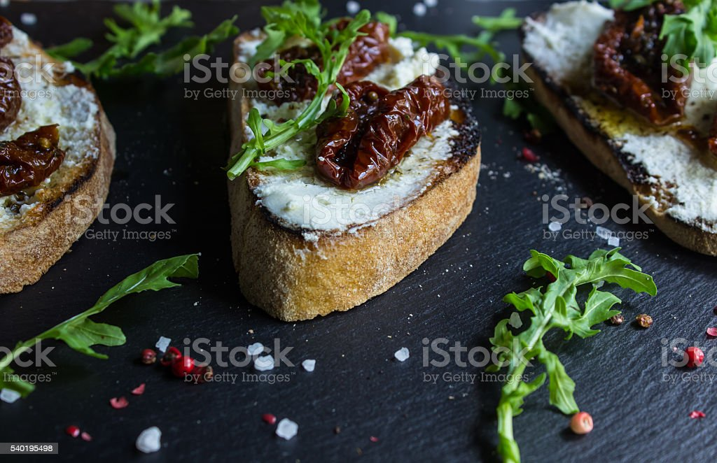 Sandwich with cheese and half dried tomatoes. stock photo